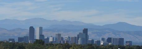 Denver Skyline Against Rocky Mountains Stockbilder