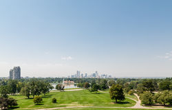 Denver Skyline Beyond Lake and Grass Lawn royalty free stock image