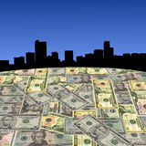 Denver skyline with dollars Royalty Free Stock Photo