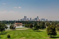 Denver Skyline Past Green Grassy Park royalty free stock photo