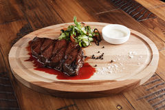 Denver steak with salad. And sauce. Wooden background Stock Photography