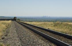 Denver Train. Colorado coal train with Denver skyline in the distance Stock Image