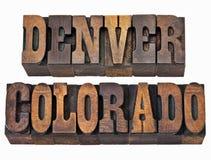 Denver und Colorado in der Briefbeschwererholzart Stockbilder