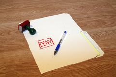 Deny. Office series with stamp and pad on desk with folder and pen. Room for text or logo royalty free stock photos