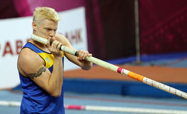 Denys Yurchenko on the Samsung Pole Vault Stars. Meeting on February 11, 2012 in Donetsk, Ukraine. He won bronze medal in the pole vault event at Summer Stock Photos