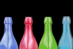 Deocorative colorful bottles on black background Royalty Free Stock Image