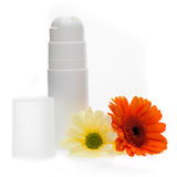 Deodorant bottle and flowers Stock Photos