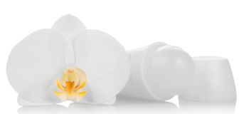 Deodorant and orchid flower Royalty Free Stock Image