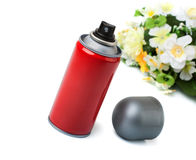 Deodorant in a red cylinder and the flowers. Stock Photography
