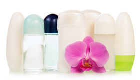Deodorants and orchid flower Royalty Free Stock Photo