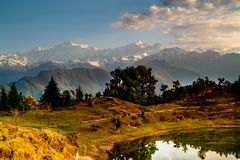 Deoria Tal Lake and Himalayas at sunrise Stock Photo