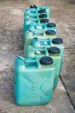 Depósitos de gasolina plásticos verdes Imagen de archivo libre de regalías