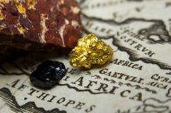 Depósitos de minério sobre um mapa de África imagens de stock