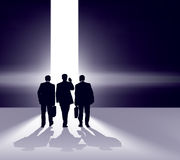 Depart. Business team walking forward through bright gap Royalty Free Stock Photography