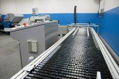 Departamento de impresión (impresión) de la prensa - línea de acabamiento Fotografía de archivo
