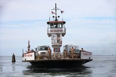 Departing Ferry Boat Hatteras North Carolina. One of the ferry boats leaving Cape Hatteras Harbor Marina carrying vehicles en route to Ocracoke Island NC Royalty Free Stock Image