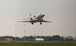 Departing International Jet Management Dassault Falcon 900EX aircraft in the rainy day Stock Photos