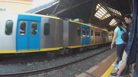 Departing light railway transit train from station. Manila, Philippines - October 26, 2015: Departing Light Rail Transit Train from passenger station, a build stock footage
