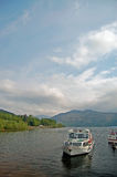 Departing on the loch Stock Images