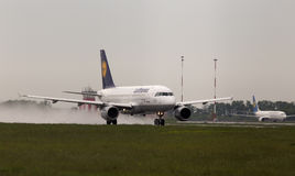 Departing Lufthansa Airbus A319-100 aircraft in the rainy day Royalty Free Stock Photo