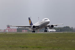 Departing Lufthansa Airbus A319-100 aircraft in the rainy day Royalty Free Stock Photos
