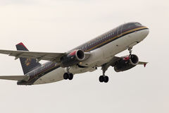 Departing Royal Jordanian Airbus A320-232 aircraft in the rainy day Stock Images