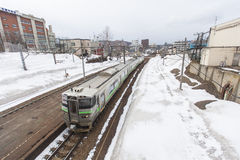 Departing train from Otaru station while snowing Stock Photography