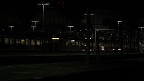 Departing train. And railroad station at night stock footage