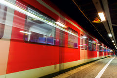 Departing train at railway station Royalty Free Stock Image