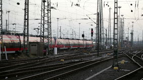 Departing train. Railyard and departing train at dusk stock video
