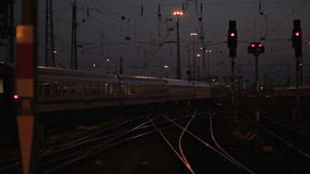 Departing train. Railyard and departing train at dusk stock footage