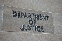 Department of Justice Sign. Sign on the exterior identifies the Department of Justice Royalty Free Stock Image