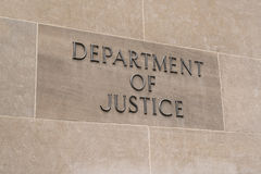 Department of Justice Sign. WASHINGTON, DC - JULY 12: United States Department of Justice sign in Washington, DC on July 12, 2017 Stock Photos