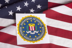 Department of justice with US flag. Department of justice Federal bureau of investigation with US flag background Stock Photo