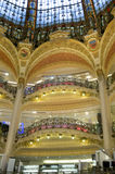 Department store 2. Modernist balconies in La Fayette department stores of Paris placed below the central dome Stock Photos