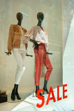 Department store sale Womenswear Germany. Two female mannequins in a showcase of a department store in Germany. The word sale is glued to the window pane. The Stock Image