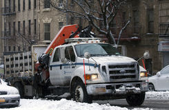 Department of Transit truck with mounted crane during snow storm Stock Photo