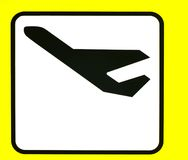 Departure. A yellow sign with a airplane departures Stock Photos