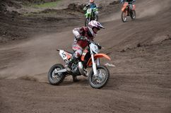 Departure with acceleration MX racer. RUSSIA, SAMARA, TOLYATTI - MAY 6: Departure with the acceleration out of the left-turn MX racer A. Matveev, the Regional Royalty Free Stock Images