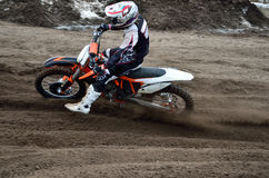 Departure with acceleration out of turn motocross stock image