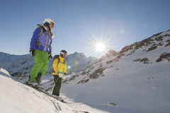 The departure - alpina ski - downhill skiing. Two skiiers watch the departure Royalty Free Stock Photos