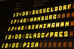 Departure board. At an airport in Spain. Flights to Dusseldorf, Hamburg, Birmingham, Glasgow and Pisa Royalty Free Stock Image