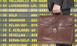 Departure board at airport Stock Photo
