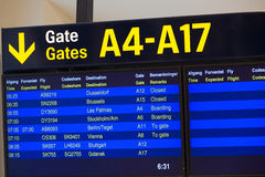 Departure board at airport. Departure information at the Kastrup Airport in Copenhagen, Denmark Royalty Free Stock Photo