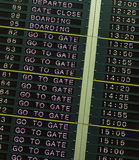 Departure board in airport Stock Image
