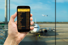 Departure board on the phone Stock Photography
