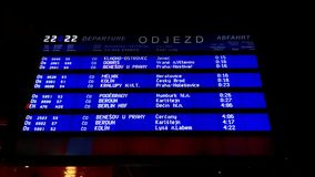 Departure board at the Prague train station. A digital departure board lists the departing trains at night at the main train station in Prague, Czech Republic stock video footage