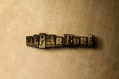 DEPARTURE - close-up of grungy vintage typeset word on metal backdrop Stock Photos