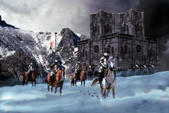 Departure for the crusades. Four knights leaving their castle in the mountains and going to the crusades, changing the cold of their snowy country for the heat Stock Photo