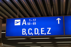 Departure gate and terminal sign in international airport Royalty Free Stock Photography